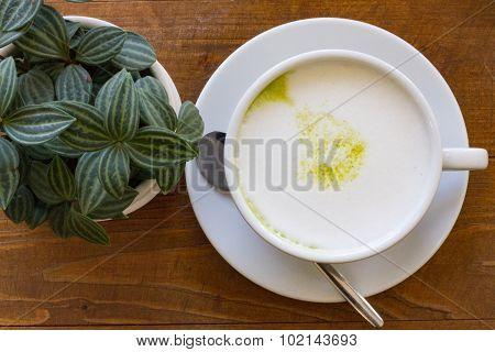 Close up hot Greentea matcha latte wood background