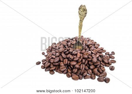 Roasted coffee bean and classic gold spoon, isolated on white background