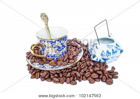 Classic luxury porcelain set and roasted coffee bean, isolated on white background