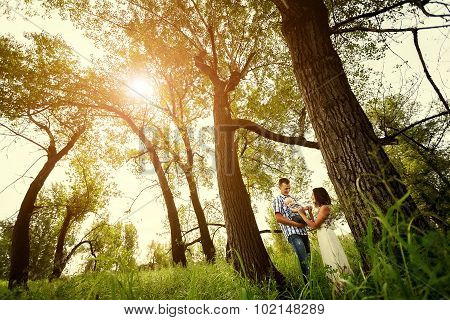 happy family in summer forest on a sunny day