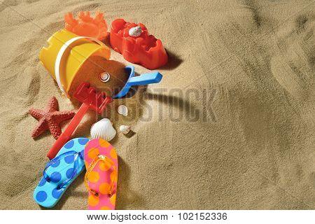 Children's flip flops on the sandy beach