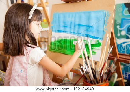 Little Girl Painting A Landscape