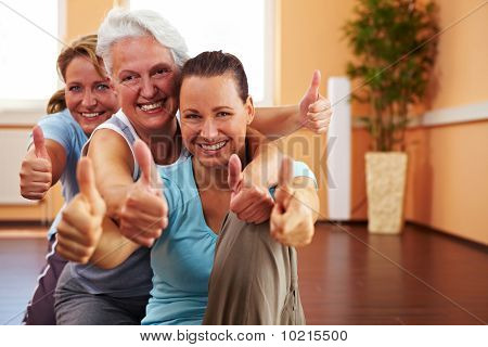 Women Holding Thumbs Up In Gym