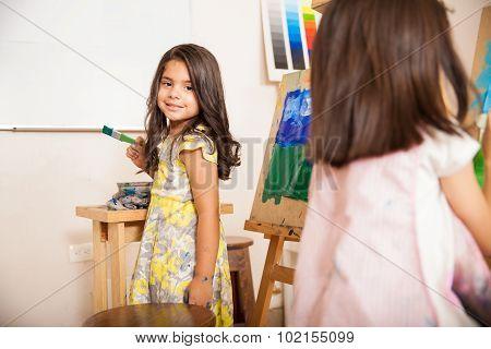 Hispanic Little Girl Enjoying Art Class