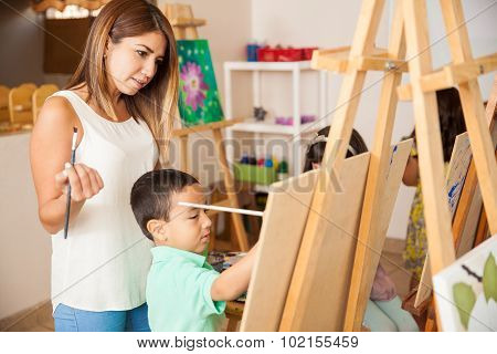 Art Teacher Grading Some Work