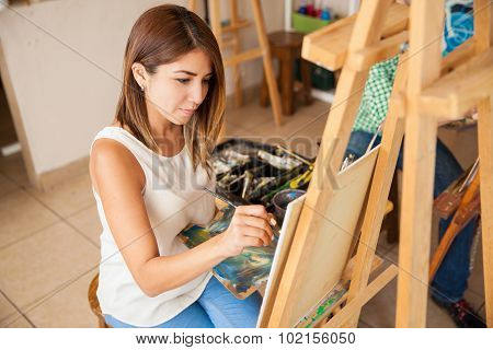 Cute Female Artist Doing Some Painting