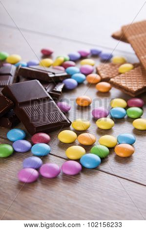 Dark Chocolate On Wooden Table With Candy