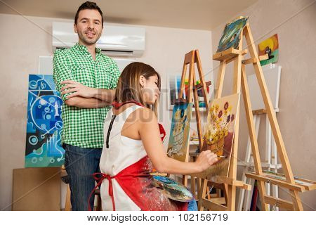 Art Instructor Working With A Student