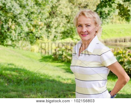 Portrait Of A Middle-aged Woman In A Park On A Sunny Day