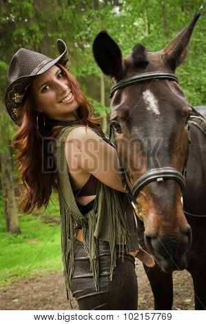 Cowgirl With Brown Horse