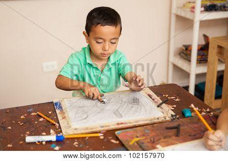 Boy Enjoying His Art Class At School