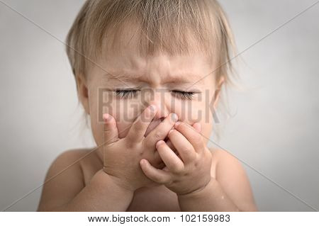 Dramatically Crying Baby Portrait