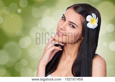 Teen female with Plumeria Flower