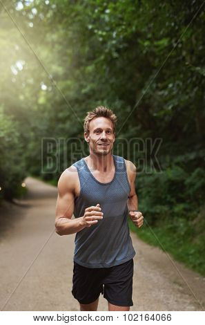 Athletic Man Running At The Park In The Morning