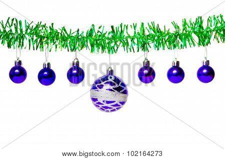 Garland Of Green Tinsel And Blue Christmas Balls