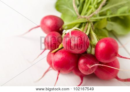 Radishes on white wooden table
