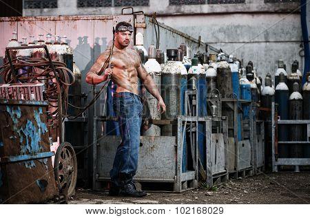 Muscular Man With An Acetylene Burner