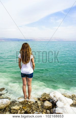 Girl Stands Near The Dead Sea