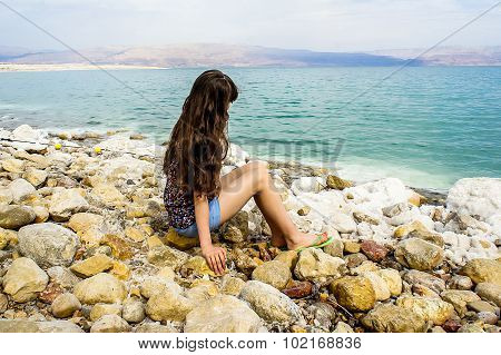 Girl Is Sitting Near The Dead Sea
