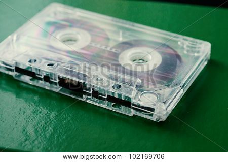 Old Audio Cassette On A Green Background Close Up