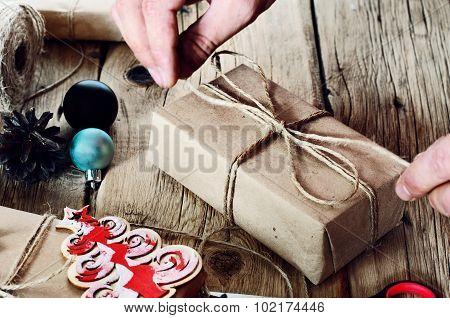 Man Tying A Christmas Present Closeup