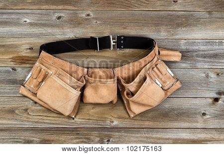 Leather Tool Belt On Rustic Wooden Boards