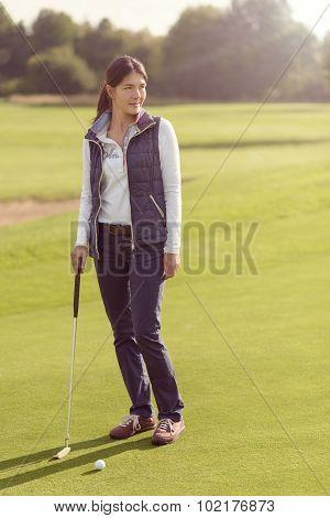 Female Golfer Standing On Green