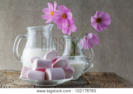 Colored Mashmallow With Milk On Wooden Table