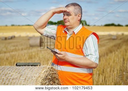 Farmer checking the hay bales