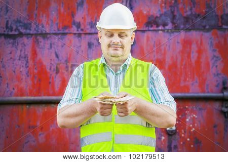 Worker with euro banknotes