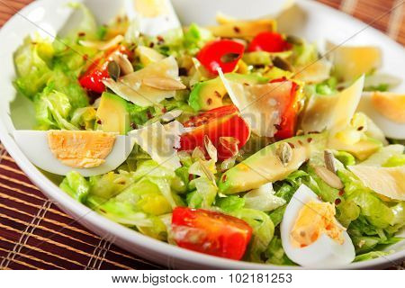 Salad With Iceberg, Cherry Tomato And Avocado