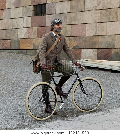 Man Wearing Old Fashioned Tweed Clothes And Bicycle