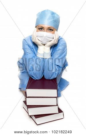 Doctor sitting with books