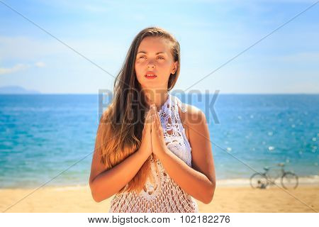 Blonde Girl In Lace Stands In Yoga Asana On Knees