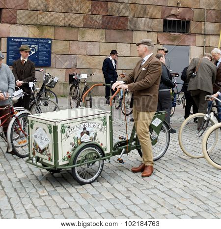 Man Sitting On A Cycle Used By Gopher Wearing Old Fashioned Brown Tweed Clothes