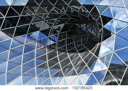 Glass facade of futuristic shopping center in Frankfurt, Germany