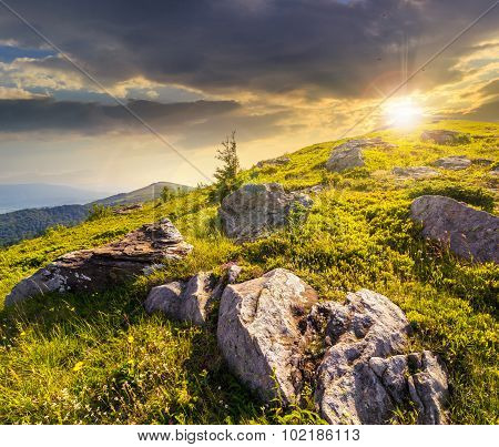 Boulders On The Hillside In High Mountains At Sunset