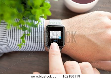 Man Hand And Watch With E-mail On The Screen