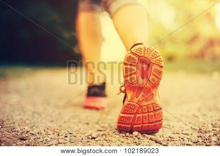 Woman Runner Feet Running Closeup And Selective Focus On Shoe