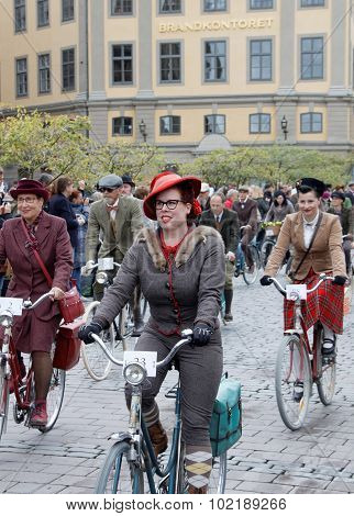 Three Elegant Cycling Woman Wearing Old Fashioned Tweed Clothes