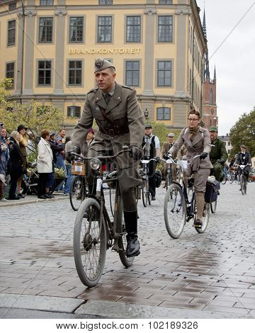 Cycling Man Wearing Old Fashioned Military Clothes