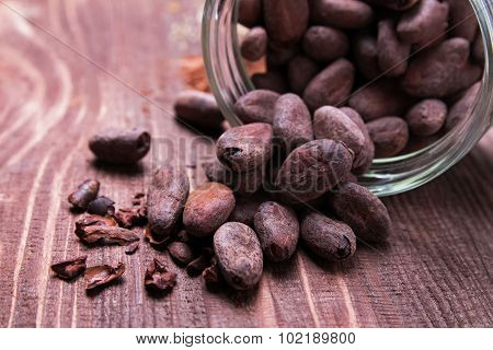 Cococa Beans Scattered On Wooden Table