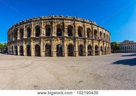 Roman amphitheater in Nimes, Provence. Magnificent huge arena perfectly preserved for two thousand years. Photo taken fisheye lens