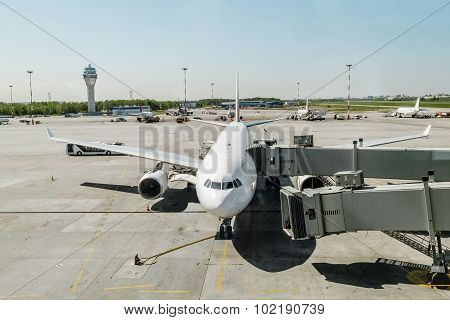 Plane With Boarding Ramp At The Airport Pulkovo.russia.