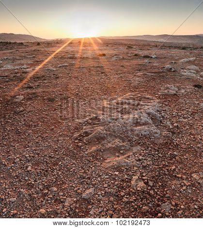 Martian Sunrise over barren rocky landscape