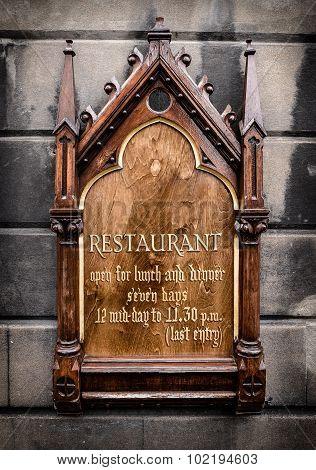 Ornate Wooden Restaurant Sign