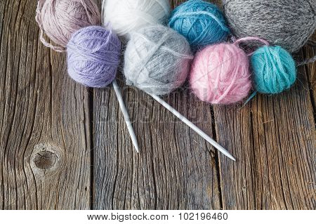 Clews Of Colored Yarn With Needle