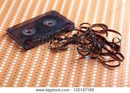 Audio Tape Cassette On A Beige Paper Background