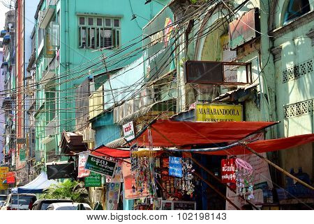 A street with local market full of wires in Yangon