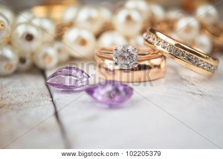 Golden wedding rings on white wood background